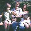 Mom with granddaughters Lauren and Keely, and her basset hound Freckles ... click for a larger version of this image.