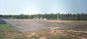 The concrete model aircraft runway outside Birmingham is only 100 yards long--the length of a football field. Before coming to a half the aircraft slid off the end and into chaparral, but came to rest before striking any trees. Click for a larger image.